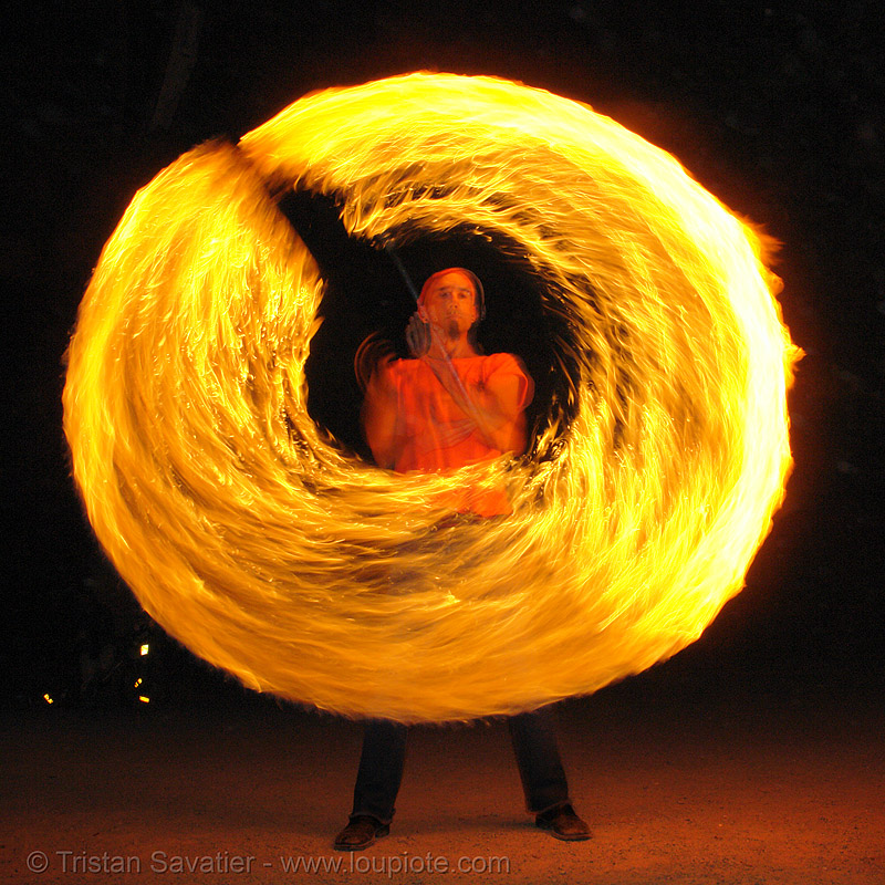 shanti (alex) spinning a fire staff (san francisco), circle, fire dancer, fire dancing, fire performer, fire spinning, flame, long exposure, night, people, ring, spinning fire