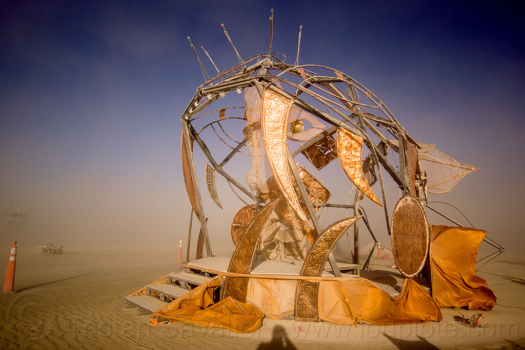 shiny fish monster sculpture - axayacoatl - burning man 2015, art installation, axayacoatl, brass, burning man, copper, deep sea fish, golden, metal, mouth, orange, quetzacoatl, sculpture, teeth