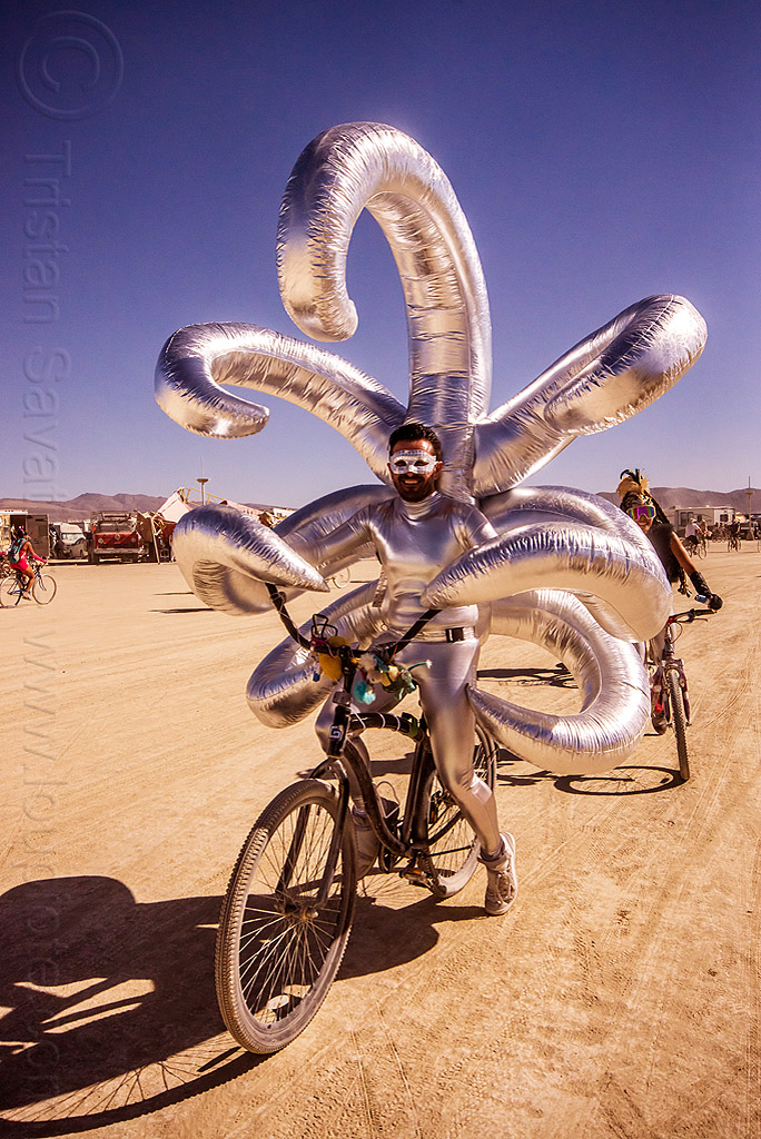 shiny inflatable costume with long arms - burning man 2015, arms, beard, bicycle, bike, burning man, inflatable costume, mask, masked, riding, shiny, tentacles, unidentified art