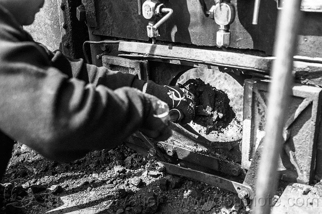 shoveling coal in furnace of steam locomotive - darjeeling (india), boiler, burning, cab, coal, darjeeling himalayan railway, darjeeling toy train, fire, flames, furnace, man, narrow gauge, railroad, shoveling, steam engine, steam locomotive, steam train engine, worker