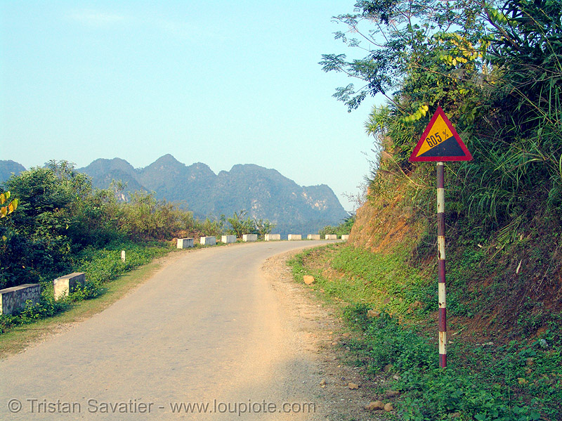sign says: grade 6.05%! - vietnam, accuracy, accurate, grade, precision, road sign, triangle, triangular, vietnam