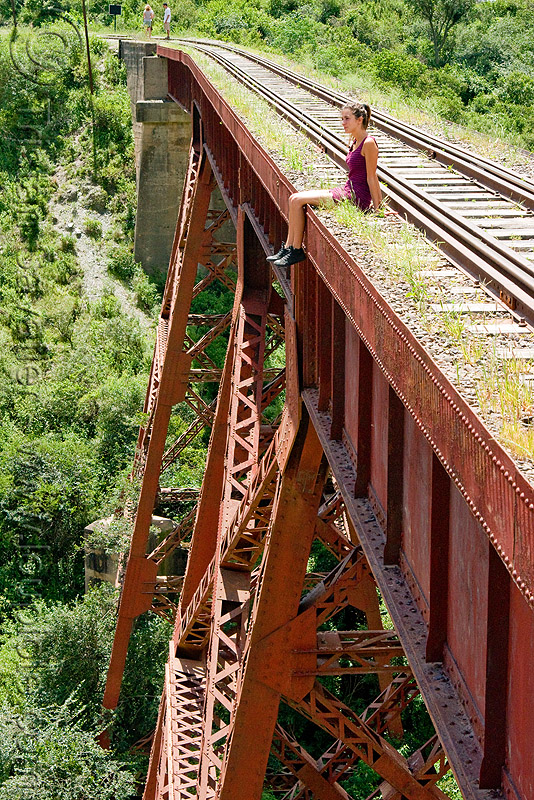 sitting at the edge - railroad viaduct, guard rails, maïlys, metric gauge, narrow gauge, noroeste argentino, rail bridge, railroad bridge, railroad tracks, railroad viaduct, railway tracks, rio toro, single track, steel, tren a las nubes, truss, viaducto del toro, woman