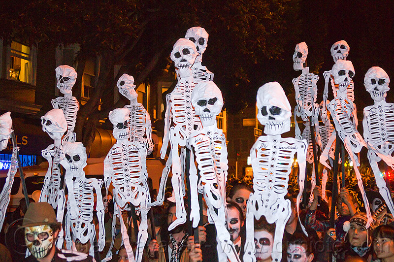skeleton paper puppets, crowd, dancing skeletons, day of the dead, dia de los muertos, halloween, night, paper skeleton puppets, paper skeletons, people, procession, street