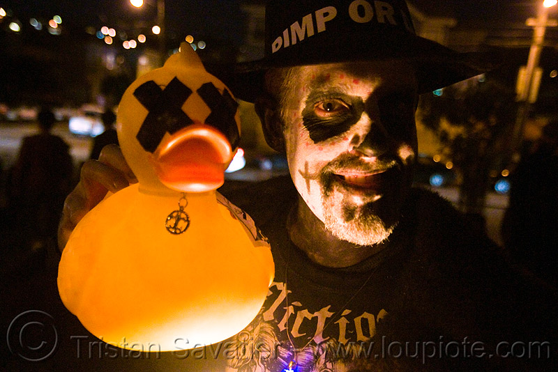 skull makeup and dead ducky - dia de los muertos - halloween (san francisco), day of the dead, dead duck, dia de los muertos, face painting, facepaint, halloween, makeup, man, night, rubber ducky