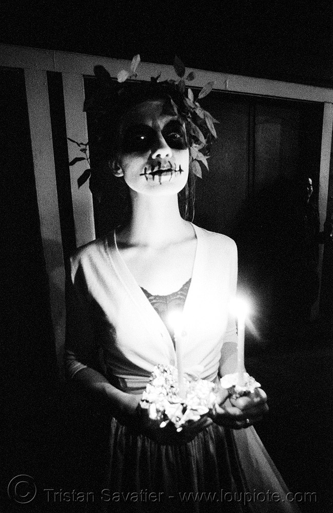 skull makeup - woman with leaves headdress - dia de los muertos - halloween (san francisco), candle, candlelight vigil, day of the dead, dia de los muertos, halloween, hat, low key, makeup, night, the mission, tmax, woman