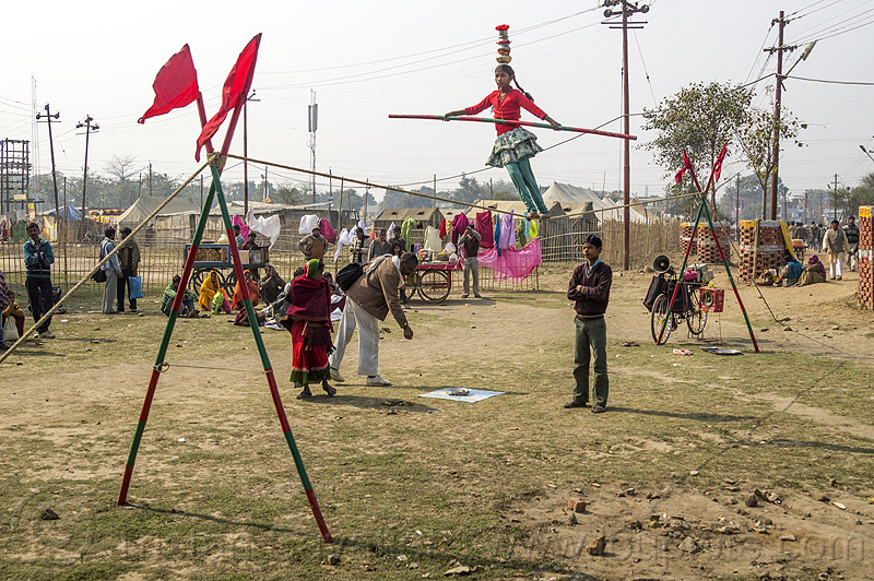 slacklining - slack rope walking - young street circus performer (india), acrobat, balancing pole, balancing stick, child, circus act, circus artist, circus performer, circus show, equilibrist, hindu pilgrimage, hinduism, india, kid, little girl, maha kumbh mela, rope walker, rope walking, slack rope, slacklining, street circus, traveling circus, woman
