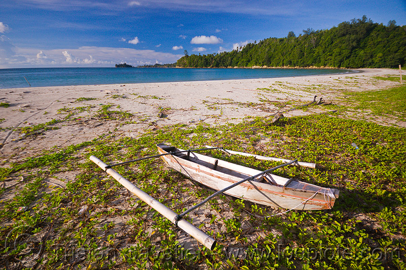 small double outrigger fishing canoe on beach (borneo), bangka, boat, borneo, climbing plants, creeper plants, desert beach, double outrigger canoe, fishing canoe, kelambu beach, malaysia, rain forest, sand, seashore