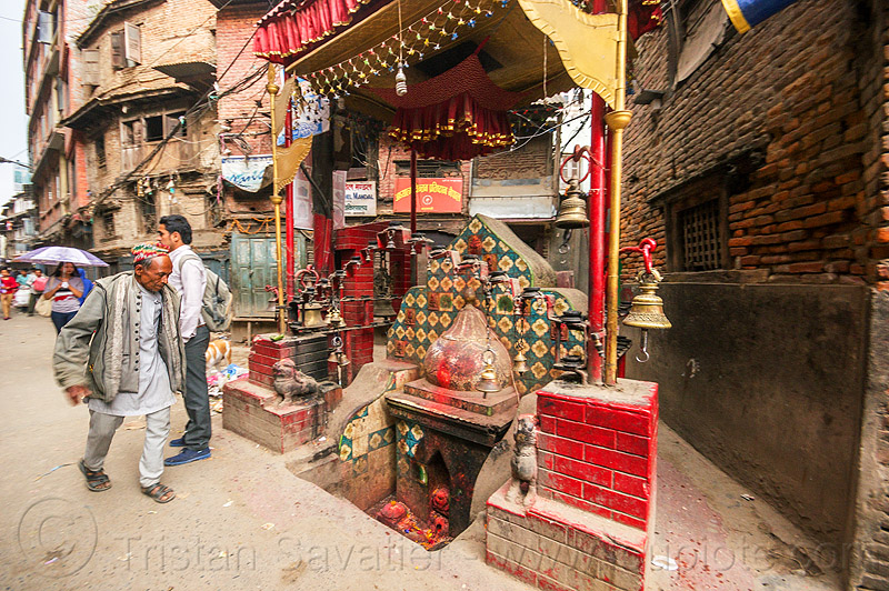 small hindu shrine in kathmandu street (nepal), balkumari, bells, ganesh, ganesha, hindu shrine, hinduism, kathmandu, men, sunken shrine