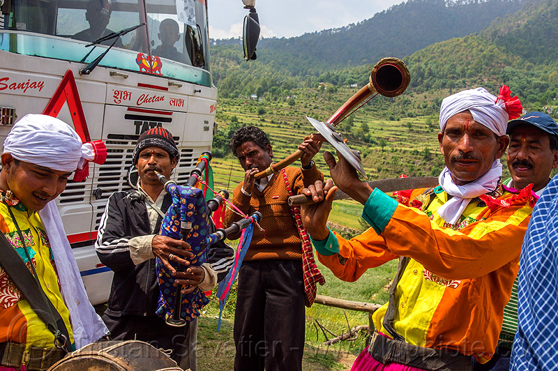 small indian marching band playing at a village wedding, bagpipe, dancing, drum, headdress, horn, indian wedding, marching band, men, musicians, playing music, sword, tola gunth, turban