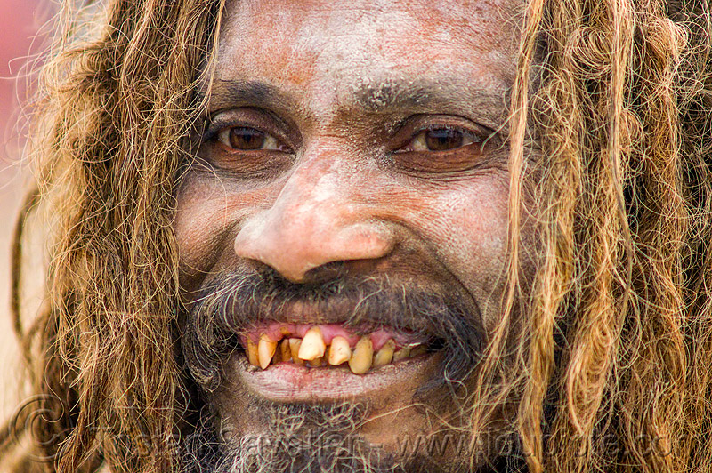 smiling sadhu with bad teeth, baba, bad teeth, beard, dreads, hindu, hinduism, holy ash, kumbha mela, maha kumbh mela, man, sacred ash, sadhu, vibhuti
