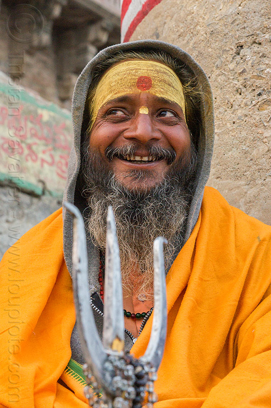 smiling sadhu with trident - hindu holy man (india), baba, beard, bhagwa, hindu, hinduism, india, man, sadhu, saffron color, tilak, trident, varanasi