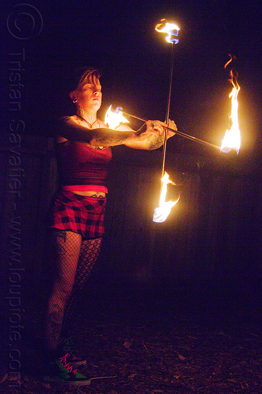 spinning crossed fire staffs, fire dancer, fire dancing, fire performer, fire spinning, fire staves, flames, leah, night, people, woman