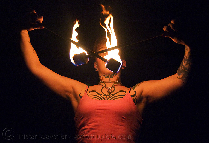 spinning fire poi (san francisco) - fire dancer - leah, fire dancing, fire performer, fire spinning, flames, night, people, tattooed, tattoos, woman