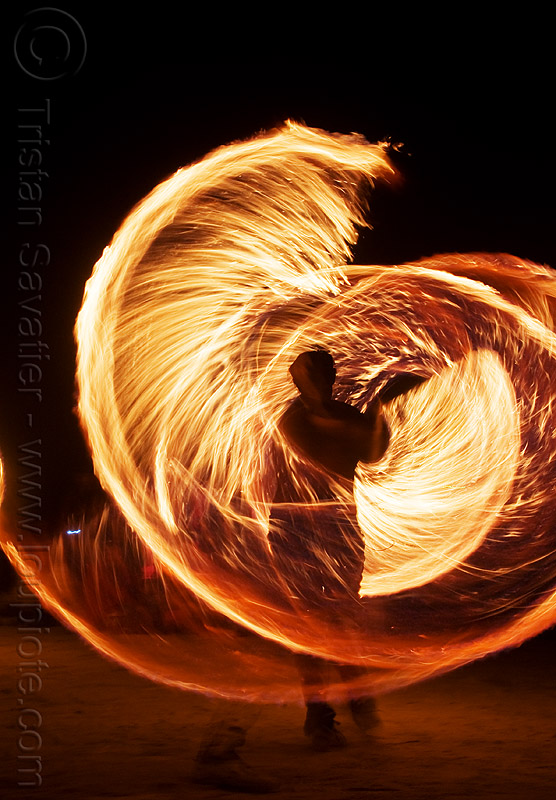 spinning fire ropes - burning man 2009, burning man, fire dancing, fire performer, fire spinning, flames, long exposure, night, rire rope, spinning fire