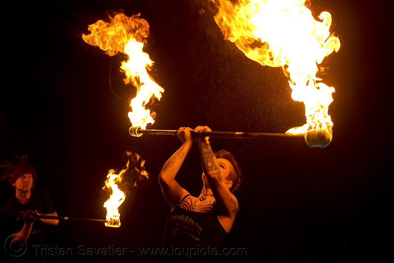 spinning fire staff (san francisco) - fire dancer - leah, fire dancer, fire dancing, fire performer, fire spinning, fire staff, flames, leah, night, spinning fire, tattooed, tattoos, woman