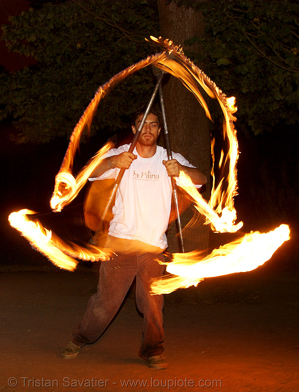 spinning fire staffs  (san francisco), double staff, fire dancer, fire dancing, fire performer, fire spinning, fire staffs, fire staves, night, spinning fire