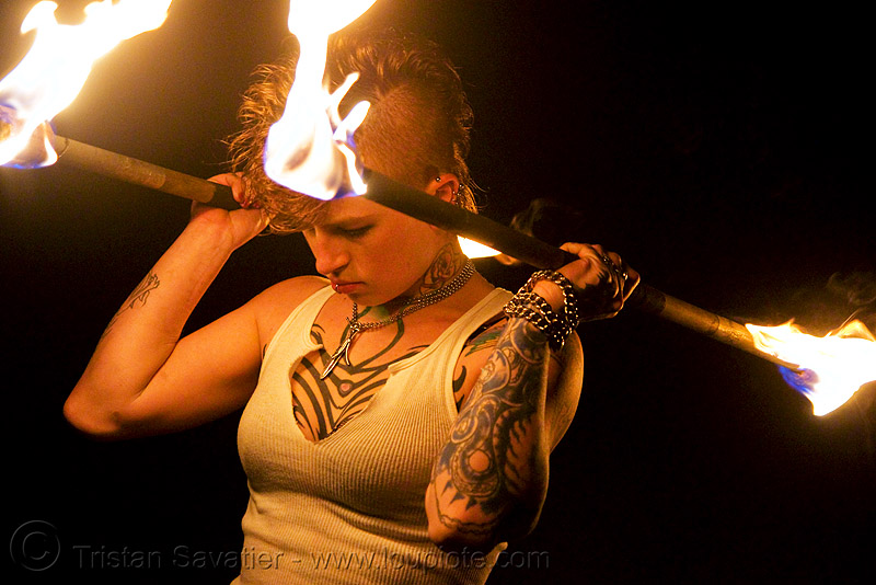 spinning fire staffs (san francisco) - fire dancer - leah, double staff, fire dancer, fire dancing, fire performer, fire spinning, fire staffs, fire staves, flames, leah, night, spinning fire, tattooed, tattoos, woman