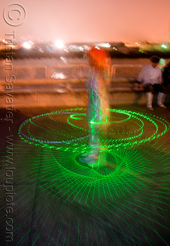 spinning green laser hulahoop, green laser, islais creek promenade, laser hoop, laser hula hoop, long exposure, night, superhero street fair, woman