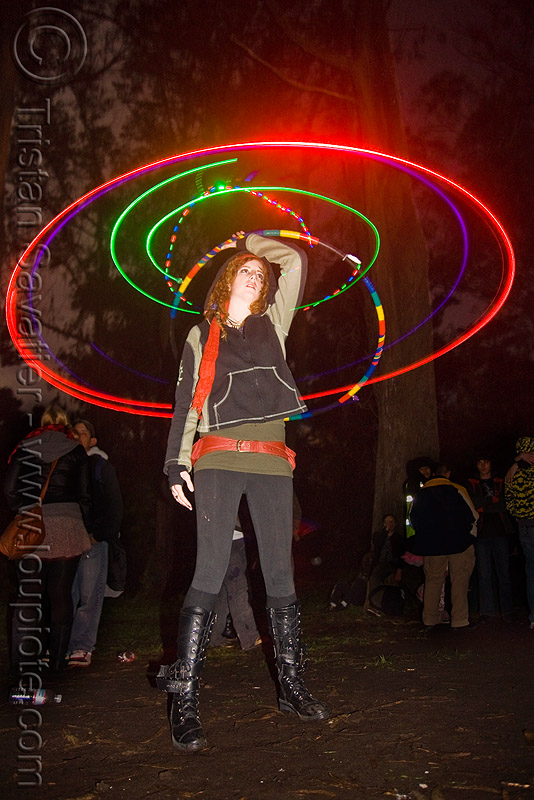 spinning a hula hoop with photon LED lights, full moon party, glowing, golden gate park, hooper, hula hooping, led hoop, led hulahoop, led-light, light hoop, long exposure, microlights, night, people, phoenix, rave lights, woman