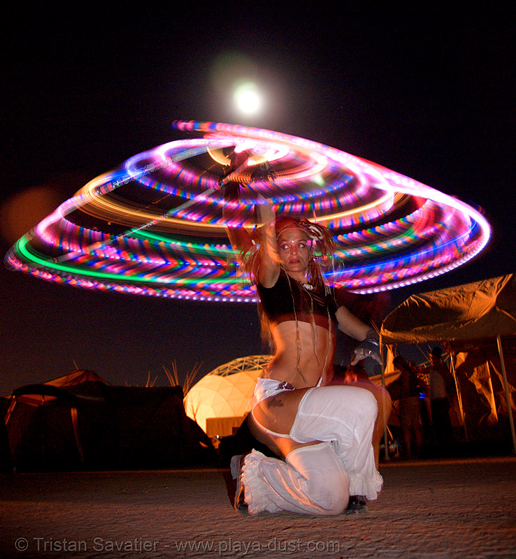 spinning a LED hulahoop - burning man 2007, burning man, full moon, glowing, hula hoop, led hoop, led lights, light hoop, night
