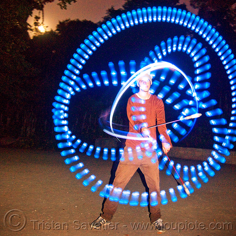 spinning LED light poi - flowlights - nicky, fire dancer, fire dancing, fire performer, fire spinning, flowtoys, glowing, led lights, led poi, led staff, light staffs, long exposure, nicky evers, night, people, spinning fire