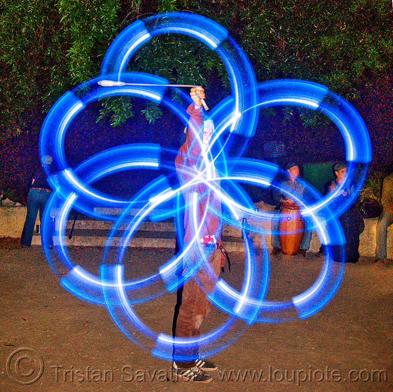 spinning LED light poi - flowlights (san francisco), fire dancer, fire dancing, fire performer, fire spinning, flowtoys, glowing, led lights, led poi, led staff, light staffs, long exposure, nicky evers, night, people, spinning fire