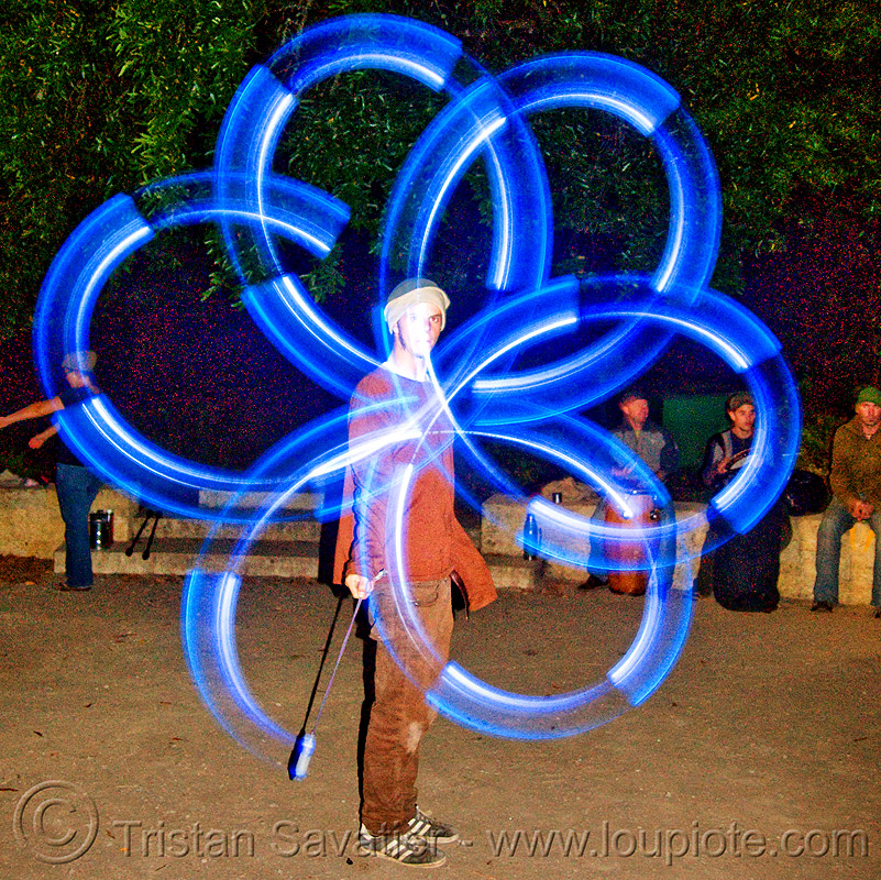 spinning LED light poi - flowlights (san francisco), fire dancer, fire dancing, fire performer, fire spinning, glowing, led lights, led poi, led staff, light poi, light staffs, nicky evers, night, spinning fire