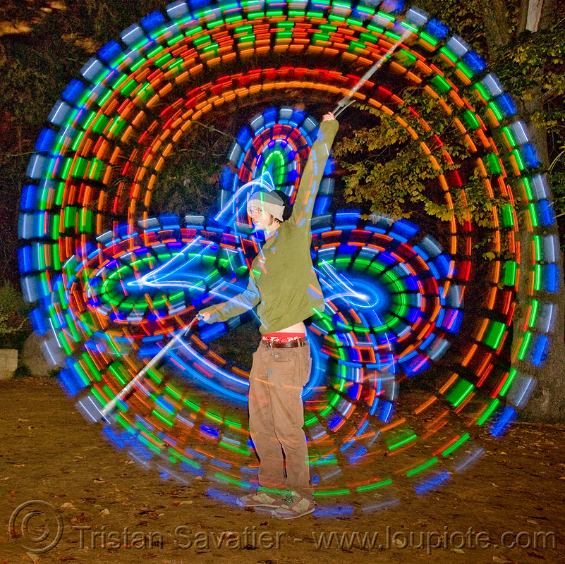 spinning LED light poi - glowing - flowlight, fire dancer, fire dancing, fire performer, fire spinning, flowlights, flowtoys, led lights, led poi, long exposure, man, nicky evers, night, people, spinning fire