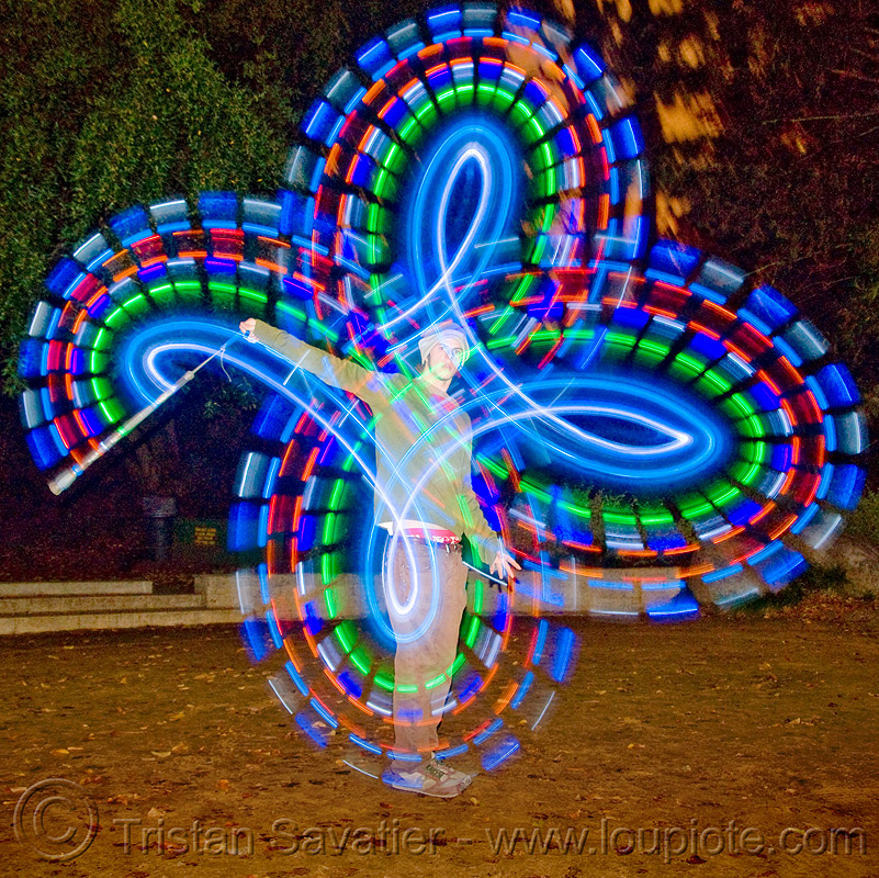 spinning LED light poi - glowing - flowlight, fire dancer, fire dancing, fire performer, fire spinning, glowing, led lights, led poi, light poi, man, nicky evers, night, spinning fire