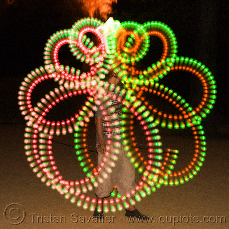 spinning LED light poi - glowing - flowlight, fire dancer, fire dancing, fire performer, fire spinning, glowing, led lights, led poi, light poi, loops, man, nicky evers, night, spinning fire, vertical symmetry