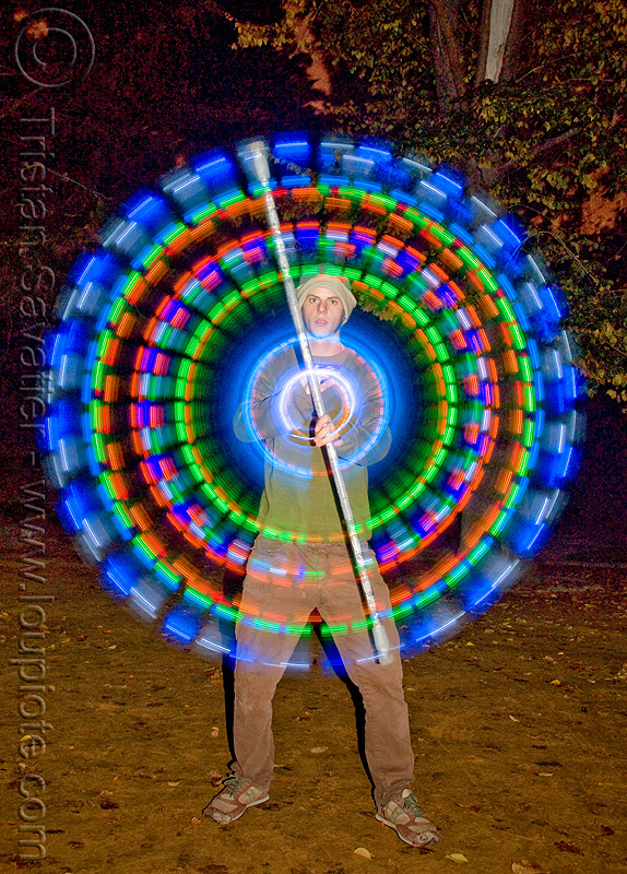 spinning LED light staff - glowing - flowlight, circle, fire dancer, fire dancing, fire performer, fire spinning, flowlights, flowtoys, glowing, led lights, led staff, light staff, long exposure, man, nicky evers, night, ring, spinning fire
