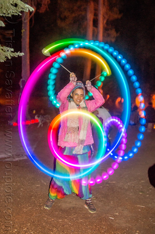 spinning light morphing LED poi, glowing, led lights, light poi, long exposure, night, paegasus flameheart, people, star camp, woman