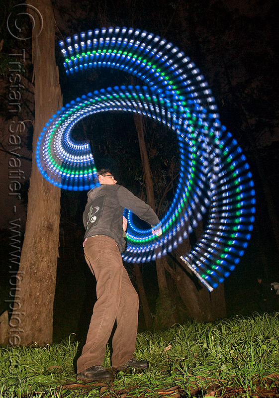 spinning staff with LED lights, flow lights, flow toys, full moon party, glowing, golden gate park, led lights, led staff, light staff, long exposure, man, night, spinning staff