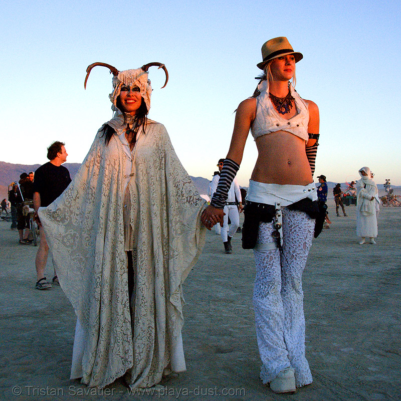 stardust at the silent white procession at dawn - burning man 2007, burning man, dawn, fedora hat, gangster hat, stardust, white morning, women