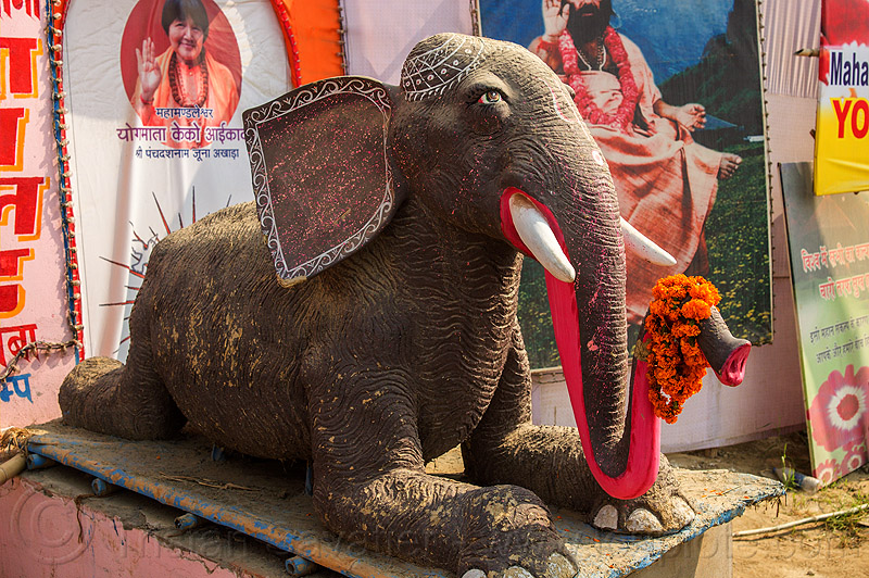 statue of elephant lying down (india), elephant, hindu pilgrimage, hinduism, india, lying down, maha kumbh mela, orange flowers, pink trunk, sculpture, statue