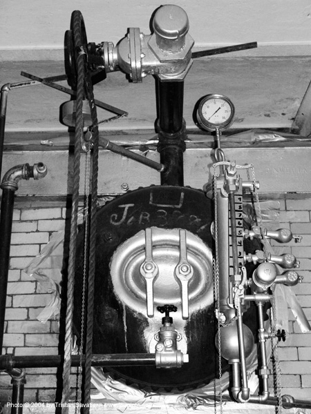 steam boiler with pressure valves in the basement of the old mint (san francisco), pipes, san francisco old mint