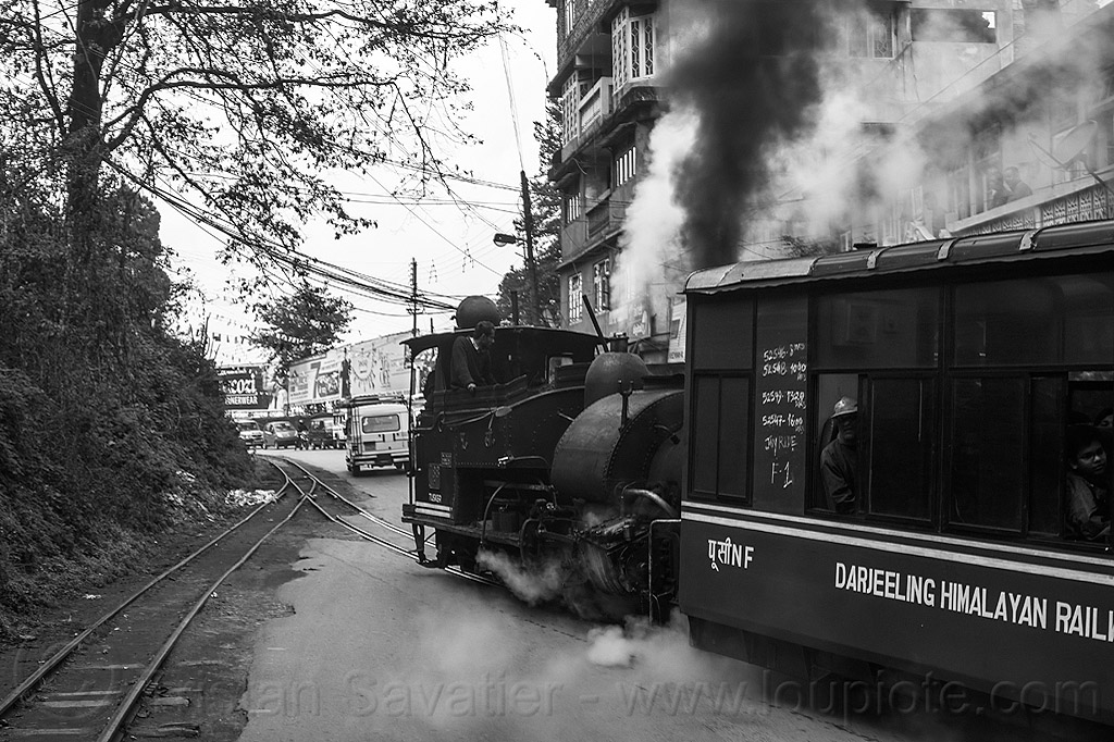 "steam locomotive pulling the darjeeling ""toy train"" (india), 782 mountaineer, darjeeling himalayan railway, darjeeling toy train, narrow gauge, railroad tracks, rails, road, smoke, smoking, steam engine, steam locomotive, steam train engine, street, train car"