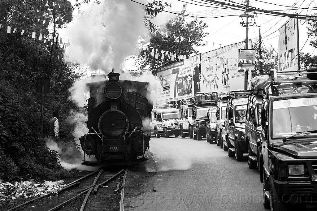 steam locomotive sharing road with cars - darjeeling (india), 788, 788 tusker, darjeeling himalayan railway, darjeeling toy train, narrow gauge, railroad, railroad switch, railroad tracks, rails, smoke, smoking, steam engine, steam train engine, street, traffic, traffic jam