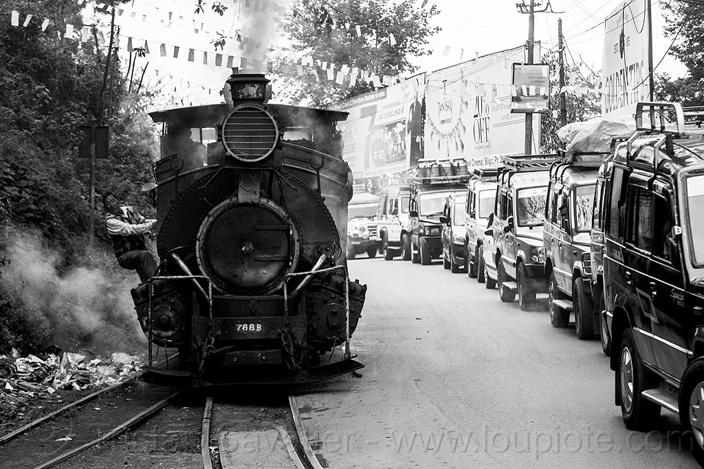 steam locomotive sharing road with cars - darjeeling (india), 788 tusker, cars, darjeeling himalayan railway, darjeeling toy train, man, narrow gauge, operator, railroad tracks, rails, road, smoke, smoking, steam engine, steam locomotive, steam train engine, street, traffic jam, worker