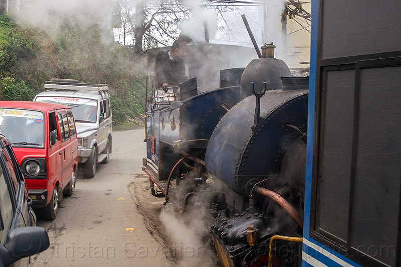 steam train sharing the road with cars - darjeeling (india), 788 tusker, darjeeling toy train, man, operator, railroad, smoke, smoking, steam engine, steam train engine, street, train car
