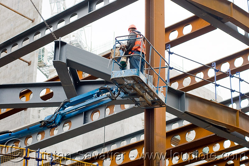 steel frame building construction - steel beams - the walbrook (london), aerial lift, boom lift, building construction, cherry picker, construction worker, crane, high-visibility jacket, high-visibility vest, hydraulic, london, reflective jacket, reflective vest, safety harness, safety helmet, steel beams, steel frame, the walbrook