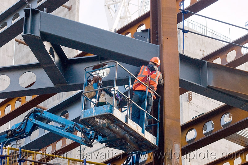 steel frame building construction - steel beams - the walbrook (london), aerial lift, boom lift, cherry picker, construction worker, crane, helmet, high-visibility jacket, high-visibility vest, hydraulic, people, reflective, reflective jacket, reflective vest, safety harness, safety helmet, working