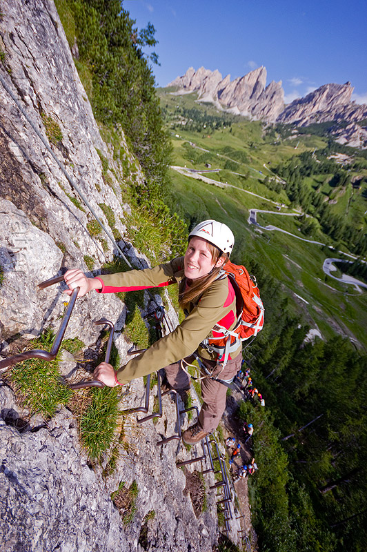 steel ladder on a cliff, alps, cliff, climber, climbing harness, climbing helmet, dolomites, dolomiti, ferrata tridentina, ladder, mountain climbing, mountaineer, mountaineering, mountains, rock climbing, vertical, via ferrata brigata tridentina, woman