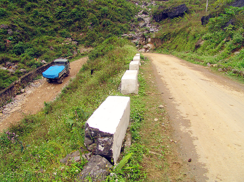 steep switchback near pass - vietnam, curves, dirt road, lorry, mountain pass, mountain road, steep, switchback, truck, turns, unpaved, winding road