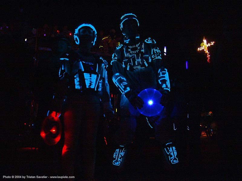 steph & gadget in their EL-wire tron costumes - burning-man 2004, art, burning man, el-wire, electroluminescent wire, gadget, night, steph, tron