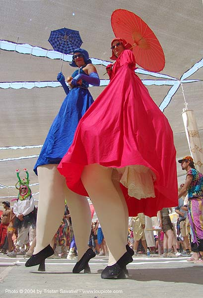 stiltwalkers in blue and red costumes with umbrellas - burning man 2004, blue, burning man, costumes, red, stilt walkers, stiltwalker, stiltwalking, women