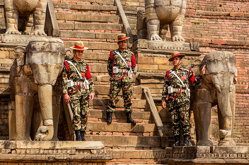 stone elephants at fasidega temple - nepali gurkha army soldiers (nepal), bhaktapur, durbar square, elephants, fatigues, gorkhas, guards, gurkha army, gurkha regiment, gurkhas, hat, hindu temple, hinduism, men, military, nepalese army, red stripe, sculptures, soldiers, stairs, statues, steps, stone elephant, uniform