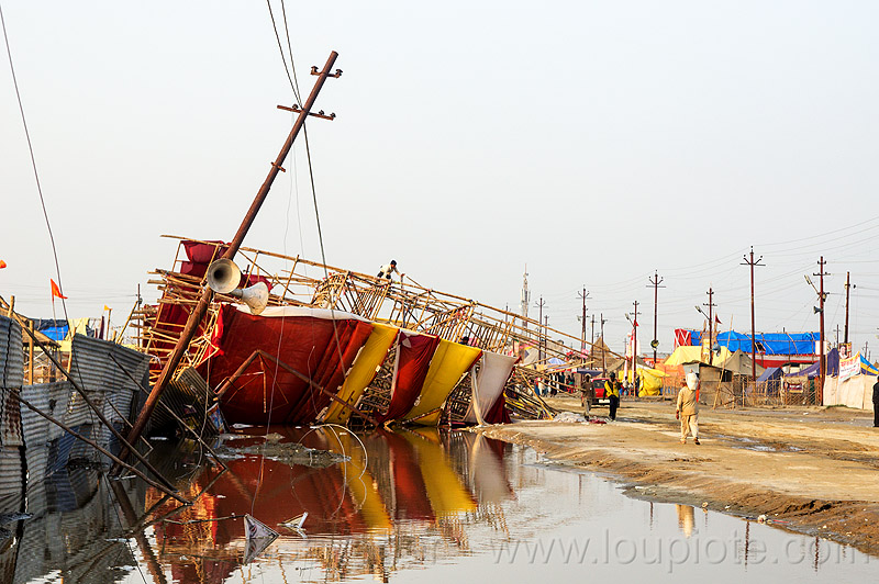 storm damage & flood - bamboo structure toppled by the wind - kumbh mela 2013 (india), ashram, broken, collapsed, destruction, flooded, gate, hindu, hinduism, infrastructure, kumbha mela, maha kumbh, maha kumbh mela, people, street, water