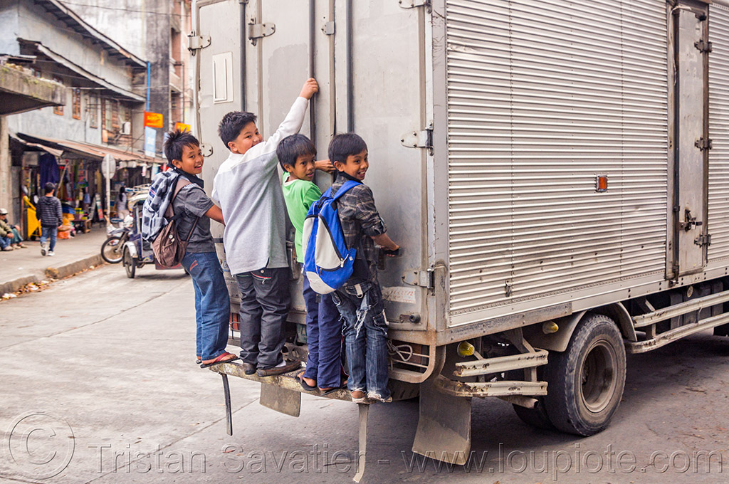 stowaways - kids hitching a free ride on the back of a truck (philippines), bontoc, boys, children, kids, philippines, stowaways, truck