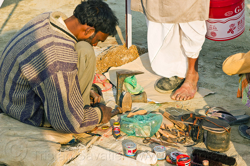 street shoemaker repairing a shoe (india), fixing, foot, hindu pilgrimage, hinduism, india, maha kumbh mela, man, repairing, shoe, shoemaker, stall, street market, street seller, street vendor, working